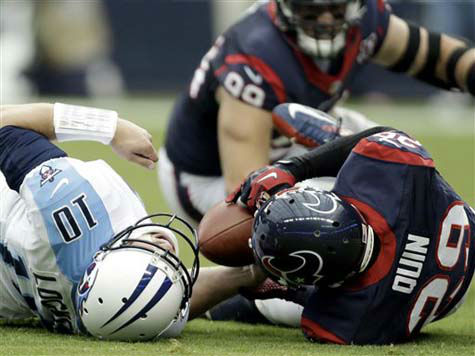 Tennessee Titans&#39; quarterback Jake Locker &#40;10&#41; is down after being sacked by Houston Texans&#39; Glover Quin &#40;29&#41; in the first quarter of an NFL football game Sunday, Sept. 30, 2012, in Houston. Locker left the field after the play.&#40;AP Photo&#47;Eric Gay&#41; <span class=meta>(Photo&#47;Eric gay)</span>