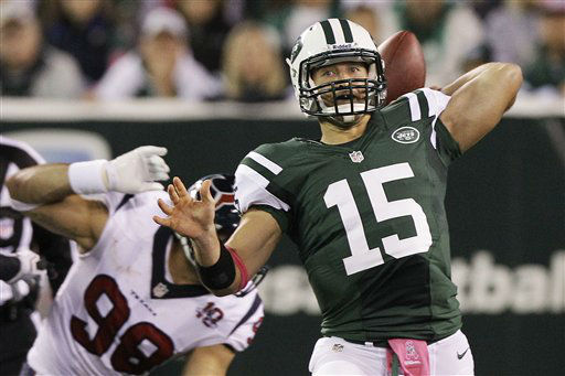 New York Jets quarterback Tim Tebow &#40;15&#41; throws a pass during the first half of an NFL football game against the Houston Texans Monday, Oct. 8, 2012, in East Rutherford, N.J. &#40;AP Photo&#47;Kathy Willens&#41; <span class=meta>(AP Photo&#47; Kathy Willens)</span>