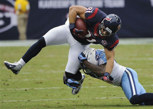 Houston Texans Owen Daniels, left, is upended by Tennessee Titans defender Jordan Babineaux, right, in the second quarter of an NFL football game Sunday, Sept. 30, 2012, in Houston. &#40;AP Photo&#47;Dave Einsel&#41; <span class=meta>(AP Photo&#47; Dave Einsel)</span>