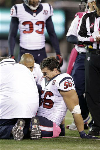 Trainers work on Houston Texans inside linebacker Brian Cushing &#40;56&#41; during the first half of an NFL football game against the New York Jets Monday, Oct. 8, 2012, in East Rutherford, N.J. &#40;AP Photo&#47;Kathy Willens&#41; <span class=meta>(AP Photo&#47; Kathy Willens)</span>