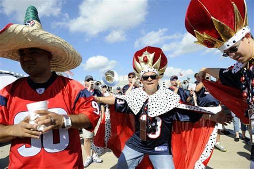 "<div class=""meta ""><span class=""caption-text "">David Nagy dances with friends before an NFL wild card playoff football game between the Houston Texans and the Cincinnati Bengals Saturday, Jan. 7, 2012, in Houston. (AP Photo/Dave Einsel) (AP Photo/ Dave Einsel)</span></div>"
