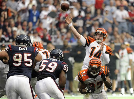 Cincinnati Bengals quarterback Andy Dalton &#40;14&#41; throws a pass over Cedric Benson &#40;32&#41; against the Houston Texans during the first quarter of an NFL wild card playoff football game Saturday, Jan. 7, 2012, in Houston. &#40;AP Photo&#47;Dave Einsel&#41; <span class=meta>(AP Photo&#47; Dave Einsel)</span>