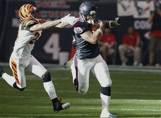 "<div class=""meta ""><span class=""caption-text "">Houston Texans running back Arian Foster (23) stays out of the reach of Cincinnati Bengals corner back Adam Jones (24) during the first quarter of an NFL wild card playoff football game Saturday, Jan. 7, 2012, in Houston. (AP Photo/Eric Gay) (AP Photo/ Eric Gay)</span></div>"