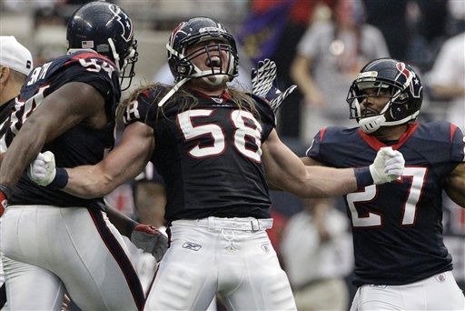 Houston Texans outside linebacker Brooks Reed &#40;58&#41; celebrates with Quintin Demps &#40;27&#41; after sacking Cincinnati Bengals quarterback Andy Dalton during the second quarter of an NFL wild card playoff football game Saturday, Jan. 7, 2012, in Houston. &#40;AP Photo&#47;Tony Gutierrez&#41; <span class=meta>(AP Photo&#47; Tony Gutierrez)</span>