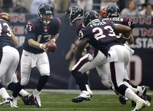 Houston Texans quarterback T.J. Yates &#40;13&#41; hands off the ball running back Arian Foster &#40;23&#41; against the Cincinnati Bengals during the first quarter of an NFL wild card playoff football game Saturday, Jan. 7, 2012, in Houston. &#40;AP Photo&#47;Tony Gutierrez&#41; <span class=meta>(AP Photo&#47; Tony Gutierrez)</span>
