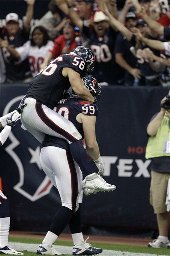 Houston Texans defensive end J.J. Watt &#40;99&#41; celebrates his interception for a touchdown with Houston Texans inside linebacker Brian Cushing &#40;56&#41; during the second quarter of an NFL wild card playoff football game against the Cincinnati Bengals Saturday, Jan. 7, 2012, in Houston. &#40;AP Photo&#47;Tony Gutierrez&#41; <span class=meta>(AP Photo&#47; Tony Gutierrez)</span>