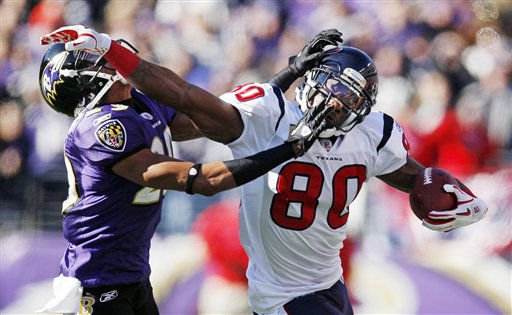 Baltimore Ravens cornerback Cary Williams stops Houston Texans wide receiver Andre Johnson during the first half of an NFL divisional playoff football game in Baltimore, Sunday, Jan. 15, 2012. &#40;AP Photo&#47;Patrick Semansky&#41; <span class=meta>(AP Photo&#47; Patrick Semansky)</span>
