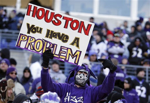 "<div class=""meta ""><span class=""caption-text "">A Baltimore Ravens fan points to his sign during the first half of an NFL divisional playoff football game against the Houston Texans in Baltimore, Sunday, Jan. 15, 2012. (AP Photo/Evan Vucci) (AP Photo/ Evan Vucci)</span></div>"
