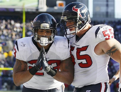 Houston Texans running back Arian Foster, left, reacts to his touchdown as center Chris Myers, right, congratulates him during the first half of an NFL divisional playoff football game against the Baltimore Ravens in Baltimore, Sunday, Jan. 15, 2012. &#40;AP Photo&#47;Patrick Semansky&#41; <span class=meta>(AP Photo&#47; Patrick Semansky)</span>