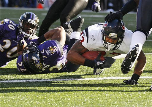 Houston Texans running back Arian Foster dives into the end zone for a touchdown leaving Baltimore Ravens inside linebacker Ray Lewis, center, and free safety Ed Reed, left, in his wake during the first half of an NFL divisional playoff football game in Baltimore, Sunday, Jan. 15, 2012. &#40;AP Photo&#47;Patrick Semansky&#41; <span class=meta>(AP Photo&#47; Patrick Semansky)</span>