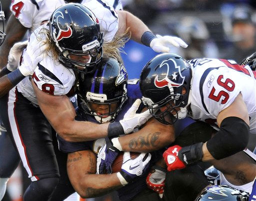 Baltimore Ravens running back Ray Rice, center, is stopped by Houston Texans outside linebacker Brooks Reed &#40;58&#41; and inside linebacker Brian Cushing &#40;56&#41; during the first half of an NFL divisional playoff football game in Baltimore, Sunday, Jan. 15, 2012. &#40;AP Photo&#47;Gail Burton&#41; <span class=meta>(AP Photo&#47; Gail Burton)</span>