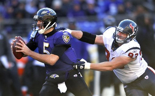 Houston Texans defensive tackle Tim Bulman, right, reaches for Baltimore Ravens quarterback Joe Flacco, left, during the first half of an NFL divisional playoff football game in Baltimore, Sunday, Jan. 15, 2012. &#40;AP Photo&#47;Gail Burton&#41; <span class=meta>(AP Photo&#47; Gail Burton)</span>