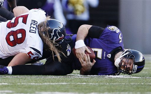 "<div class=""meta ""><span class=""caption-text "">Baltimore Ravens quarterback Joe Flacco reacts after begin hit by Houston Texans outside linebacker Brooks Reed during the second half of an NFL divisional playoff football game in Baltimore, Sunday, Jan. 15, 2012. (AP Photo/Patrick Semansky) (AP Photo/ Patrick Semansky)</span></div>"