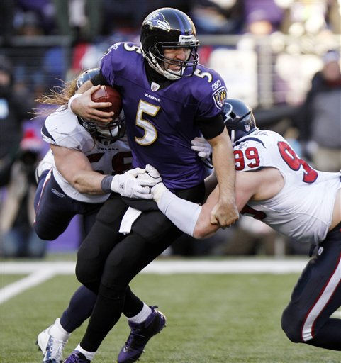 Baltimore Ravens quarterback Joe Flacco, center, is sacked by Houston Texans outside linebacker Brooks Reed, left, and defensive end J.J. Watt, right, during the second half of an NFL divisional playoff football game in Baltimore, Sunday, Jan. 15, 2012. &#40;AP Photo&#47;Evan Vucci&#41; <span class=meta>(AP Photo&#47; Evan Vucci)</span>