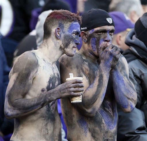 "<div class=""meta image-caption""><div class=""origin-logo origin-image ""><span></span></div><span class=""caption-text"">Baltimore Ravens fans try to stay warm as they watch the action on the field during the second half of an NFL divisional playoff football game against the Houston Texans in Baltimore, Sunday, Jan. 15, 2012. (AP Photo/Patrick Semansky) (AP Photo/ Patrick Semansky)</span></div>"
