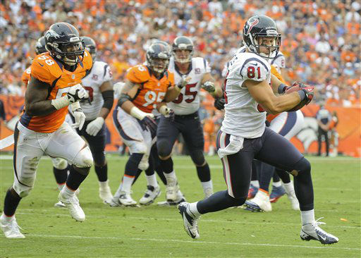 Houston Texans tight end Owen Daniels &#40;81&#41; runs for a touchdown as Denver Broncos outside linebacker Von Miller &#40;58&#41; pursues in the third quarter of an NFL football game Sunday, Sept. 23, 2012, in Denver. &#40;AP Photo&#47;Jack Dempsey&#41; <span class=meta>(AP Photo&#47; Jack Dempsey)</span>