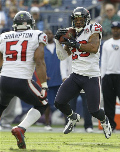 Houston Texans safety Glover Quin &#40;29&#41; intercepts a pass thrown by Tennessee Titans quarterback Jake Locker, not shown, in the second quarter of an NFL football game on Sunday, Dec. 2, 2012, in Nashville, Tenn. At left is Texans inside linebacker Darryl Sharpton &#40;51&#41;. &#40;AP Photo&#47;Wade Payne&#41; <span class=meta>(AP Photo&#47; Wade Payne)</span>