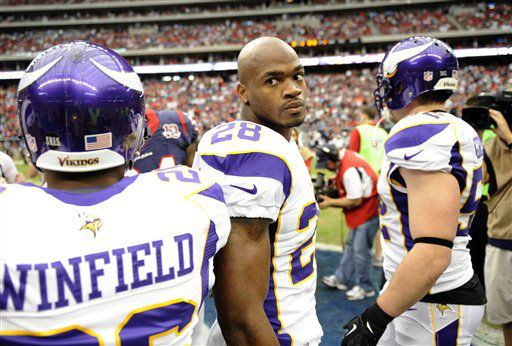 Minnesota Vikings running back Adrian Peterson &#40;28&#41; takes part in the coin toss before an NFL football game against the Houston Texans Sunday, Dec. 23, 2012, in Houston. &#40;AP Photo&#47;Dave Einsel&#41; <span class=meta>(AP Photo&#47; Dave Einsel)</span>