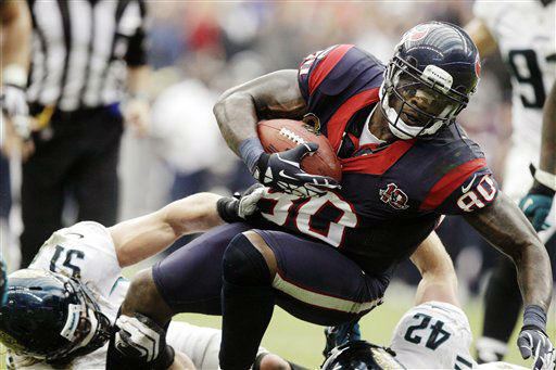 Houston Texans wide receiver Andre Johnson &#40;80&#41; is tackled by Jacksonville Jaguars Paul Posluszny &#40;51&#41; and Chris Prosinski &#40;42&#41; during the fourth quarter of an NFL football game, Sunday, Nov. 18, 2012, in Houston.   <span class=meta>(AP Photo&#47; Patric Schneider)</span>