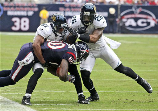 Houston Texans&#39; Andre Johnson &#40;80&#41; is tackled by Jacksonville Jaguars Derek Cox &#40;21&#41; and Dawan Landry &#40;26&#41; during the second quarter of an NFL football game on Sunday, Nov. 18, 2012, in Houston.   <span class=meta>(AP Photo&#47; Patric Schneider)</span>