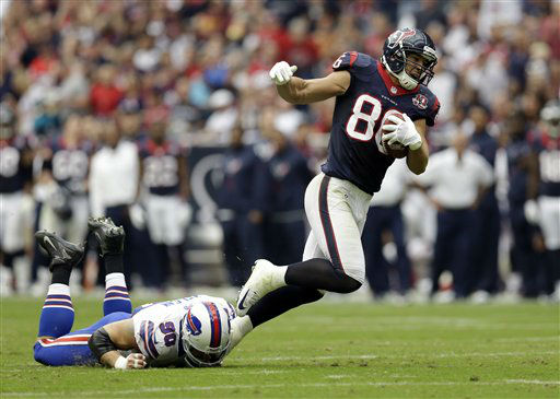 Houston Texans fullback James Casey &#40;86&#41; is tripped up by Buffalo Bills&#39; Chris Kelsay &#40;90&#41; in the second quarter of an NFL football game Sunday, Nov. 4, 2012, in Houston. &#40;AP Photo&#47;Eric Gay&#41; <span class=meta>(AP Photo&#47; Eric Gay)</span>