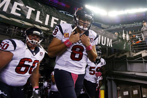 Houston Texans quarterback Matt Schaub &#40;8&#41; walks on the field with teammates  Ben Jones &#40;60&#41;, and  Whitney Mercilus &#40;59&#41; before an NFL football game against the New York Jets Monday, Oct. 8, 2012, in East Rutherford, N.J. &#40;AP Photo&#47;Julio Cortez&#41; <span class=meta>(AP Photo&#47; Julio Cortez)</span>