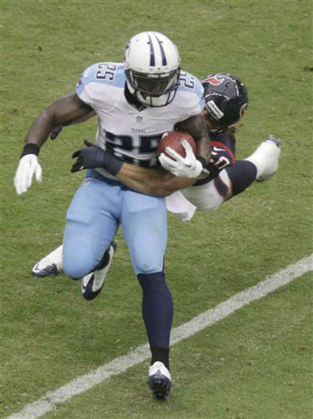 Tennessee Titans wide receiver Darius Reynaud &#40;25&#41; is tackled by Houston Texans&#39; Bryan Braman &#40;50&#41; in the first quarter of an NFL football game Sunday, Sept. 30, 2012, in Houston. &#40;AP Photo&#47;Patric Schneider&#41; <span class=meta>(Photo&#47;Pat Sullivan)</span>