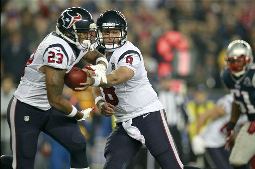 Houston Texans quarterback Matt Schaub &#40;8&#41; hands off to running back Arian Foster &#40;23&#41; during the first quarter of an NFL football game against the New England Patriots in Foxborough, Mass., Monday, Dec. 10, 2012. &#40;AP Photo&#47;Steven Senne&#41; <span class=meta>(AP Photo&#47; Steven Senne)</span>