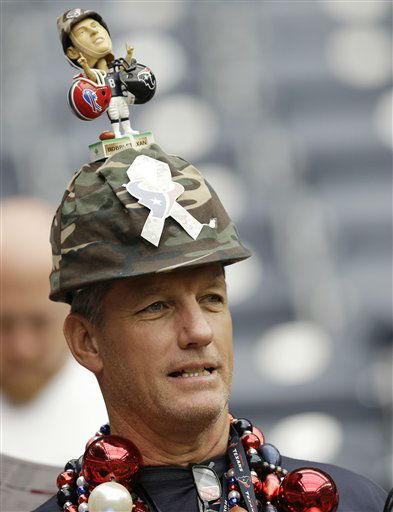 A Houston Texans fan wears a camouflage helmet for Salute to Service before an NFL football game against the Buffalo Bills Sunday, Nov. 4, 2012, in Houston. &#40;AP Photo&#47;Eric Gay&#41; <span class=meta>(AP Photo&#47; Eric Gay)</span>