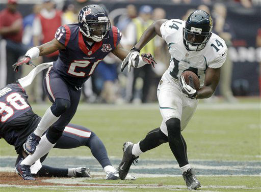 Jacksonville Jaguars wide receiver Justin Blackmon &#40;14&#41; breaks away from Houston Texans defensive back Brice McCain &#40;21&#41; for a touchdown during the fourth quarter of an NFL football game Sunday, Nov. 18, 2012, in Houston.   <span class=meta>(AP Photo&#47; Patric Schneider)</span>