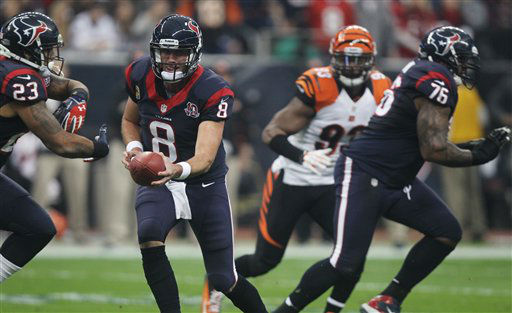 Houston Texans quarterback Matt Schaub (8) fakes a handoff to running back Arian Foster (23) during the first quarter of an NFL wild card playoff football game Saturday, Jan. 5, 2013, in Houston. (AP Photo/Patric Schneider)