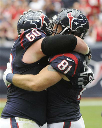 Houston Texans Ben Jones &#40;60&#41; and Owen Daniels &#40;81&#41; celebrate a touchdown against the Buffalo Bills in the first quarter of an NFL football game Sunday, Nov. 4, 2012, in Houston. &#40;AP Photo&#47;Dave Einsel&#41; <span class=meta>(AP Photo&#47; Dave Einsel)</span>