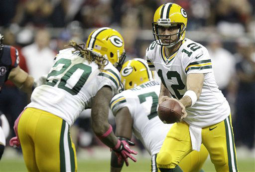 Green Bay Packers quarterback Aaron Rodgers &#40;12&#41; hands the ball off to Alex Green &#40;20&#41; in the second quarter of an NFL football game against the Houston Texans Sunday, Oct. 14, 2012 in Houston. &#40;AP Photo&#47;Patric Schneider&#41; <span class=meta>(AP Photo&#47; Patric Schneider)</span>