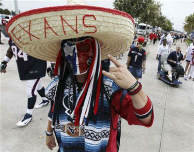 "<div class=""meta image-caption""><div class=""origin-logo origin-image ""><span></span></div><span class=""caption-text"">A Houston Texans fan mug for the camera outside Reliant Stadium before an NFL football game between the Houston Texans and the Tennessee Titans Sunday, Sept. 30, 2012, in Houston. (AP Photo/Patric Schneider) (Photo/Patric Schneider)</span></div>"