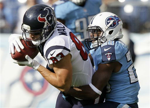 Houston Texans wide receiver Kevin Walter &#40;83&#41; is pulled down by Tennessee Titans defensive back Alterraun Verner &#40;20&#41; in the first quarter of an NFL football game on Sunday, Dec. 2, 2012, in Nashville, Tenn.   <span class=meta>(AP Photo&#47; Wade Payne)</span>