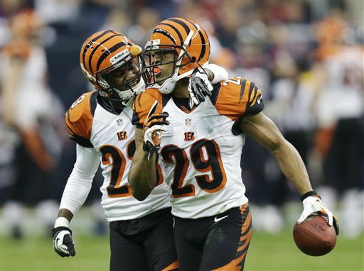 "<div class=""meta ""><span class=""caption-text "">Cincinnati Bengals cornerback Leon Hall (29) celebrates with Terence Newman after scoring a touchdown on an interception from Houston Texans quarterback Matt Schaub during the second quarter of an NFL wild card playoff football game Saturday, Jan. 5, 2013, in Houston. (AP Photo/Eric Gay) (AP Photo/ Eric Gay)</span></div>"