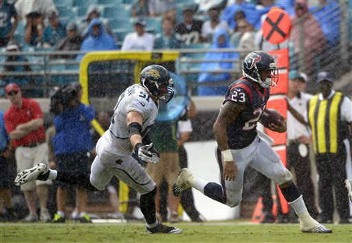 Houston Texans running back Arian Foster &#40;23&#41; breaks away from Jacksonville Jaguars middle linebacker Paul Posluszny &#40;51&#41; during the first half an NFL football game, Sunday, Sept. 16, 2012, in Jacksonville, Fla. &#40;AP Photo&#47;Phelan M. Ebenhack&#41; <span class=meta>(AP Photo&#47; Phelan M. Ebenhack)</span>