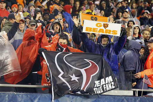 Chicago Bears fans and Houston Texans fans hold signs cheering their teams on in the first half an NFL football game in Chicago, Sunday, Nov. 11, 2012.   <span class=meta>(AP Photo&#47; Charles Rex Arbogast)</span>
