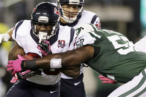 Houston Texans running back Justin Forsett &#40;28&#41; is tackled by New York Jets inside linebacker David Harris &#40;52&#41; during the first half of an NFL football game, Monday, Oct. 8, 2012, in East Rutherford, N.J. &#40;AP Photo&#47;Kathy Willens&#41; <span class=meta>(AP Photo&#47; Kathy Willens)</span>