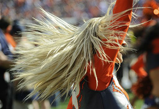 "<div class=""meta ""><span class=""caption-text "">A Denver Broncos cheerleader performs during halftime of an NFL football game against the Houston Texans, Sunday, Sept. 23, 2012, in Denver. (AP Photo/Jack Dempsey) (AP Photo/ Jack Dempsey)</span></div>"
