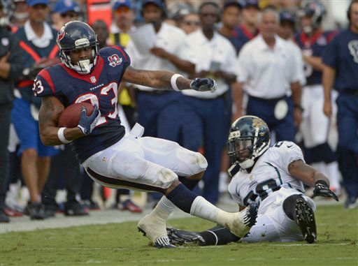 Houston Texans running back Arian Foster &#40;23&#41; is tackled by Jacksonville Jaguars free safety Dawan Landry, right, during the first half an NFL football game, Sunday, Sept. 16, 2012, in Jacksonville, Fla. &#40;AP Photo&#47;Phelan M. Ebenhack&#41; <span class=meta>(AP Photo&#47; Phelan M. Ebenhack)</span>