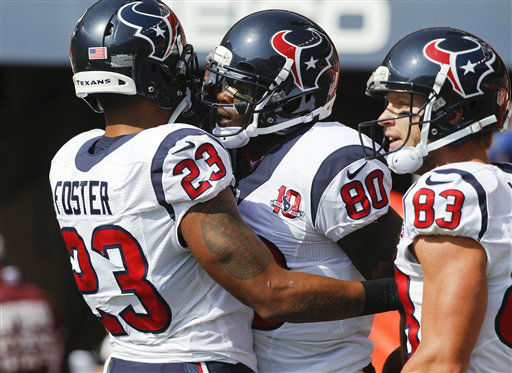 Houston Texans wide receiver Andre Johnson &#40;80&#41; celebrates with running back Arian Foster &#40;23&#41; and wide receiver Kevin Walter &#40;83&#41; after scoring on a touchdown pass against the Denver Broncos in the first quarter of an NFL football game Sunday, Sept. 23, 2012, in Denver. &#40;AP Photo&#47;David Zalubowski&#41; <span class=meta>(AP Photo&#47; David Zalubowski)</span>