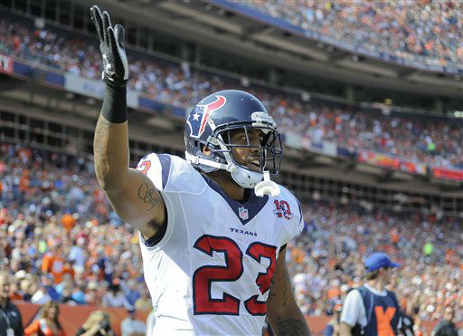 Houston Texans running back Arian Foster &#40;23&#41; reacts after scoring a touchdown against the Denver Broncos in the first quarter of an NFL football game Sunday, Sept. 23, 2012, in Denver. &#40;AP Photo&#47;Jack Dempsey&#41; <span class=meta>(AP Photo&#47; Jack Dempsey)</span>