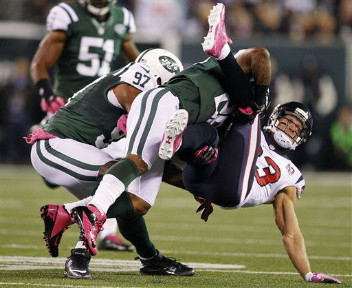 New York Jets defensive back Ellis Lankster &#40;26&#41; tackles Houston Texans wide receiver Kevin Walter &#40;83&#41; during the first half of an NFL football game, Monday, Oct. 8, 2012, in East Rutherford, N.J. &#40;AP Photo&#47;Julio Cortez&#41; <span class=meta>(AP Photo&#47; Julio Cortez)</span>