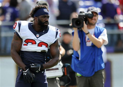 Houston Texans free safety Ed Reed warms up before an NFL football game against the Baltimore Ravens, Sunday, Sept. 22, 2013, in Baltimore.  <span class=meta>(AP Photo&#47;Gail Burton)</span>