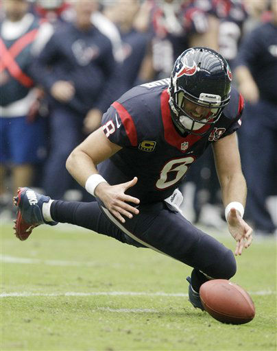 Houston Texans quarterback Matt Schaub fumbles the ball against the Jacksonville Jaguars during the first quarter of an NFL football game Sunday, Nov. 18, 2012, in Houston. Schaub recovered the ball.  <span class=meta>(AP Photo&#47; Patric Schneider)</span>