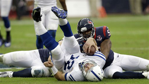 "<div class=""meta ""><span class=""caption-text "">Indianapolis Colts quarterback Andrew Luck (12) is sacked by Houston Texans inside linebacker Bradie James (53) and J.J. Watt, left, in the first quarter of an NFL football game Sunday, Dec. 16, 2012, in Houston.   (AP Photo/ Eric Gay)</span></div>"