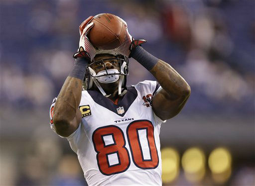 Houston Texans' Andre Johnson (80) makes a catch before an NFL football game against the Indianapolis Colts Sunday, Dec. 30, 2012, in Indianapolis. (AP Photo/Michael Conroy)