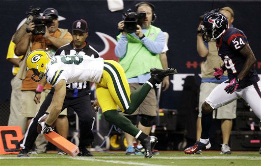 Green Bay Packers wide receiver Jordy Nelson, left, falls into the end zone for a touchdown ahead of Houston Texans cornerback Johnathan Joseph &#40;24&#41; in the first quarter of an NFL football game, Sunday, Oct. 14, 2012, in Houston. &#40;AP Photo&#47;Patric Schneider&#41; <span class=meta>(AP Photo&#47; Patric Schneider)</span>