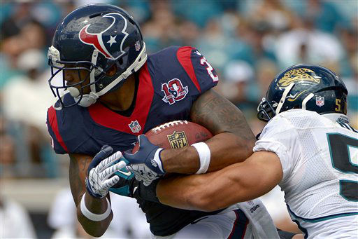 Houston Texans running back Arian Foster, left, is tackled after a short gain by Jacksonville Jaguars outside linebacker Russell Allen during the first half of an NFL football game, Sunday, Sept. 16, 2012, in Jacksonville, Fla. &#40;AP Photo&#47;Phelan M. Ebenhack&#41; <span class=meta>(AP Photo&#47; Phelan M. Ebenhack)</span>